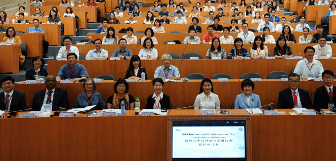 "Linda B. Cottler seated with other delegates from the Taiwan Food and Drug Administration host ""2019 International Conference on New Psychoactive Substances"