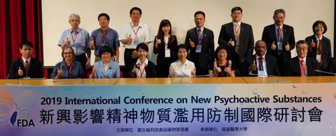 "A thumbs up is given by Linda B. Cottler and other delegates from the Taiwan Food and Drug Administration host ""2019 International Conference on New Psychoactive Substances"