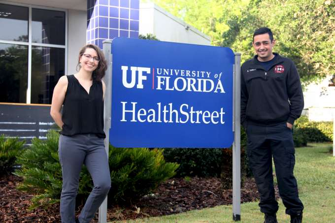 HealthStreet's first Volunteer Firefighter CHWs stand in front of the HealthStreet sign