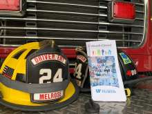 HealthStreet brochures rest on the bumper of a firetruck at the Melrose Fire Department
